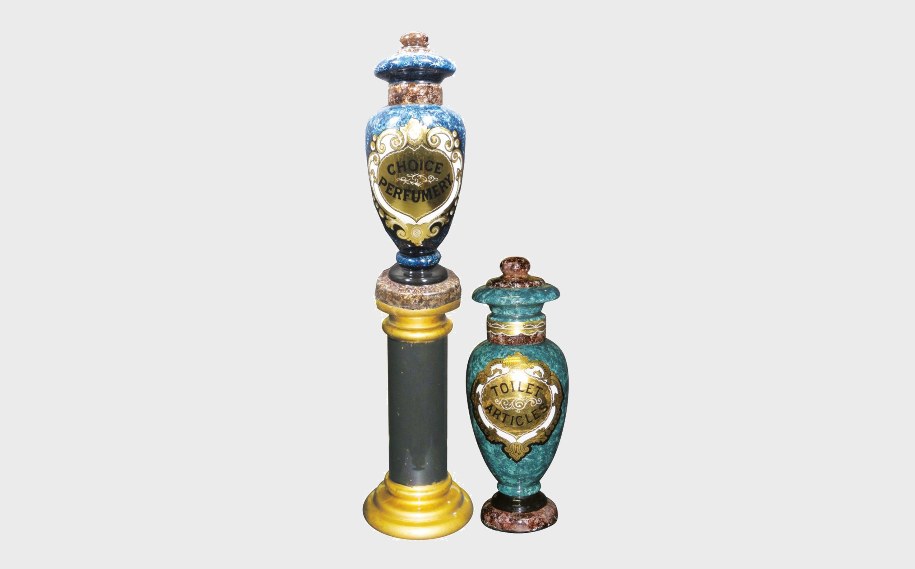 Two reverse Glass Show Globes